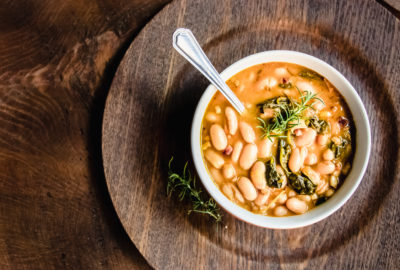 Italian White Bean Soup food photography on wooden table