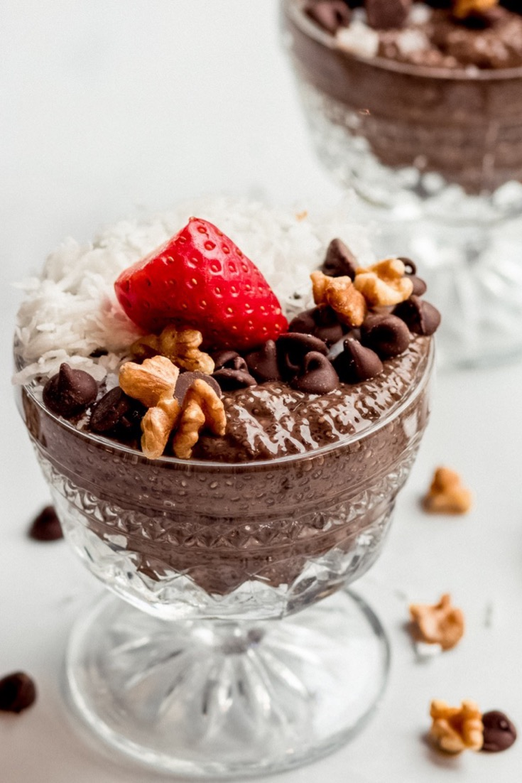 German Chocolate Chia Pudding in glass antique bowls with strawberry on top
