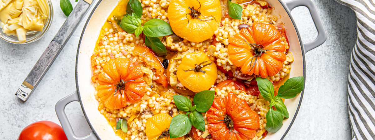 Mediterranean Couscous Stuffed Tomatoes with Feta and Artichokes