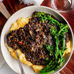bbq lentils over cheese grits with a broccoli robe garnish