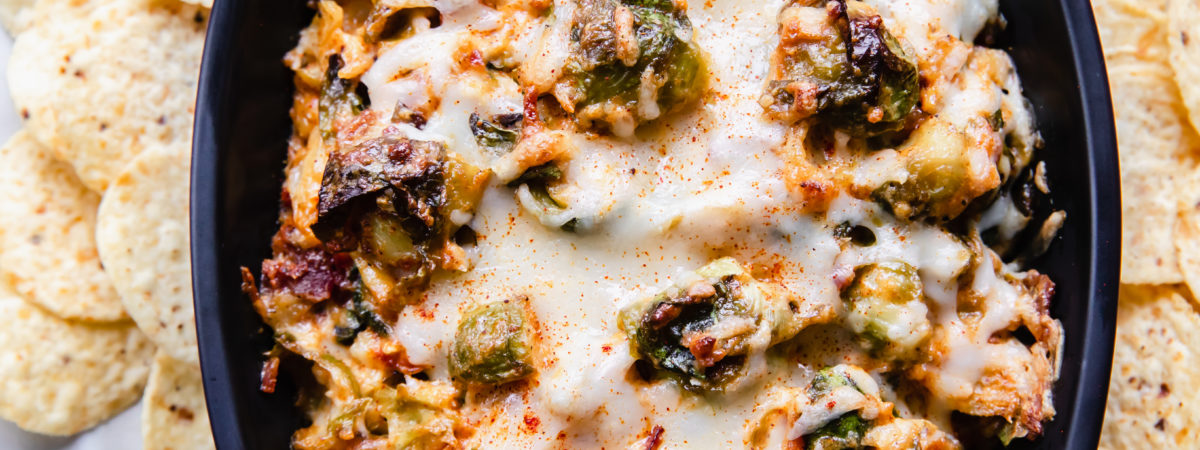 baked hot cheesy brussel sprout and bacon dip